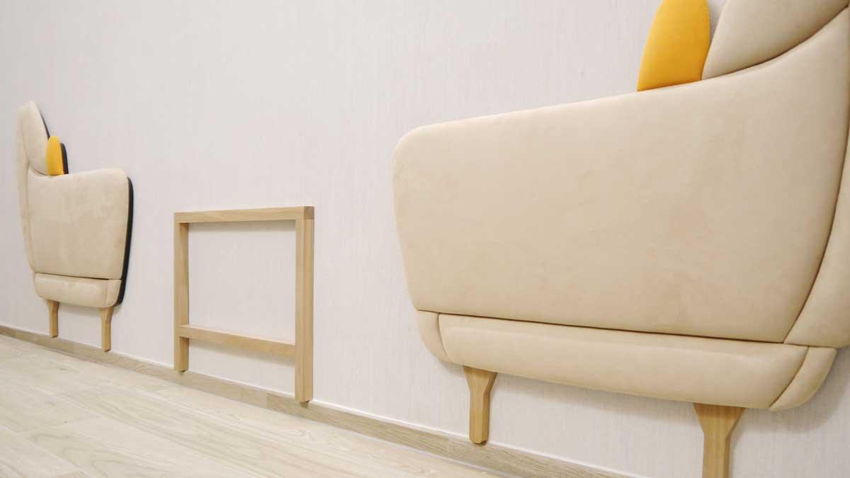 Aufwendige Wandgestaltungen mit gepolsterten Paneelen im Beratungsraum Wohnen