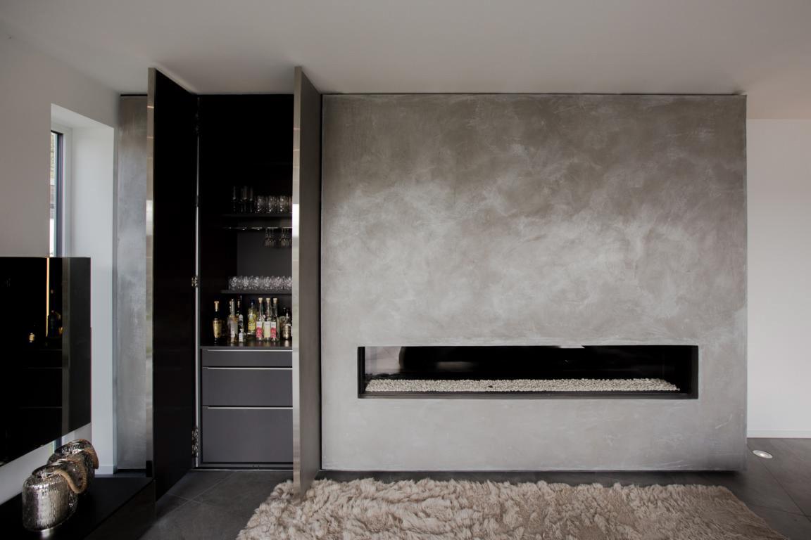 Kaminbar mit Beton-Oberfläche und Pocket Doors
